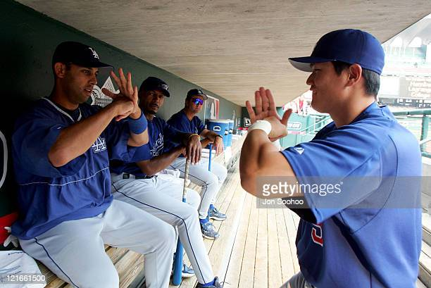 Los Angeles Dodgers Alex Cora and Hee Seop Choi go through pregame ritual before game against the St Louis Cardinals September 3 2004 at Busch...