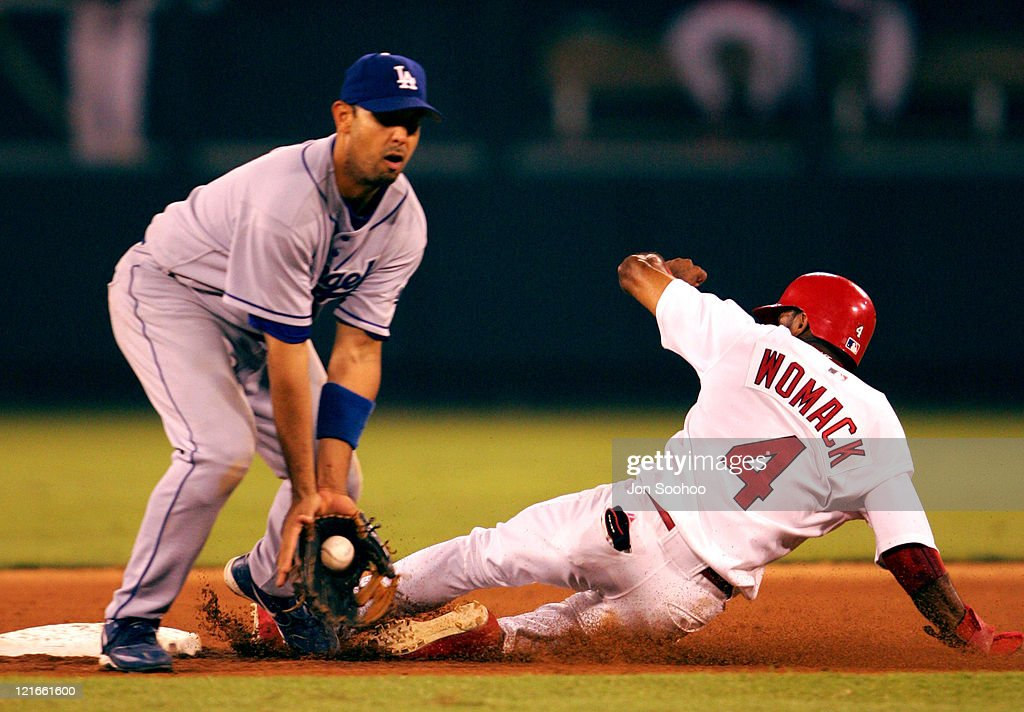 Los Angeles Dodgers Alex Cora can't get St. Louis Cardinals Tony Womack Saturday, September 4, 2004 at Busch Stadium in St. Louis, Missouri.The Cardinals beat the Dodgers 5-1.