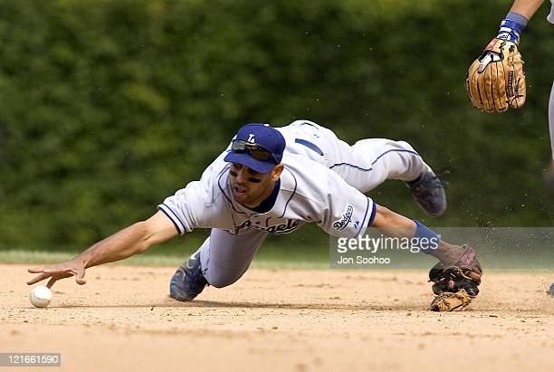 Los Angeles Dodgers Alex Cora can't get to the ball hit by Chicago Cubs Ramon Martinez in the fourth inning Friday August 13 2004 at Wrigley Field in...