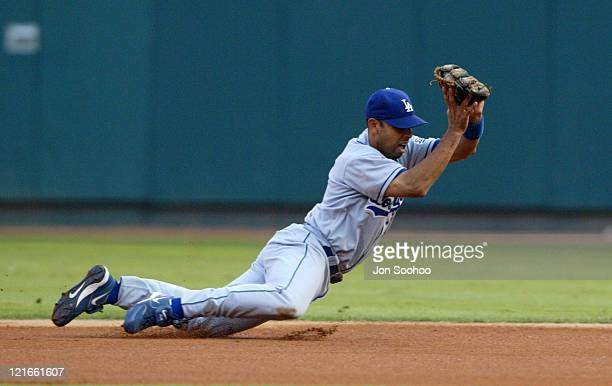 Los Angeles Dodgers Alex Cora dives and gets St Louis Cardinals So Taguchi in the 3rd inning Saturday September 4 2004 at Busch Stadium in St Louis...