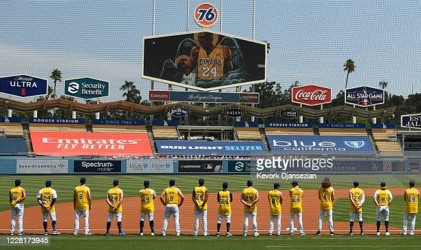 Los Angeles Dodgers and the Colorado Rockies line up with the Dodgers players wearing Kobe Bryant's Los Angeles Lakers jersey in honor of the late...
