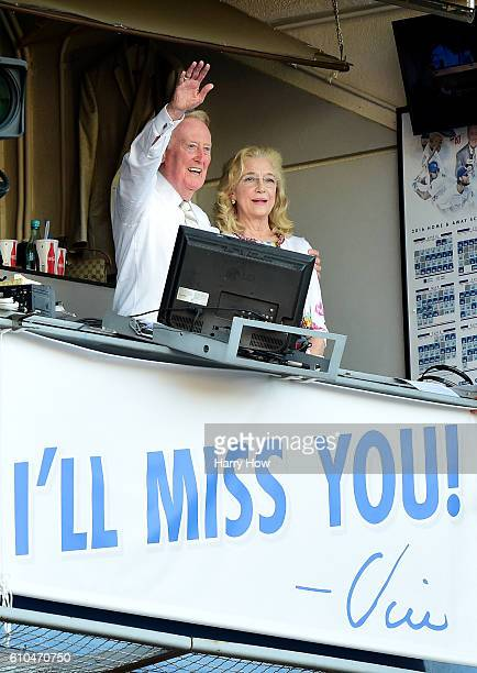 Los Angeles Dodgers announcer Vin Scully and his wife Sandra Hunt acknowedge the crowds applause for his 67 years of service after a 4-3 win over the...