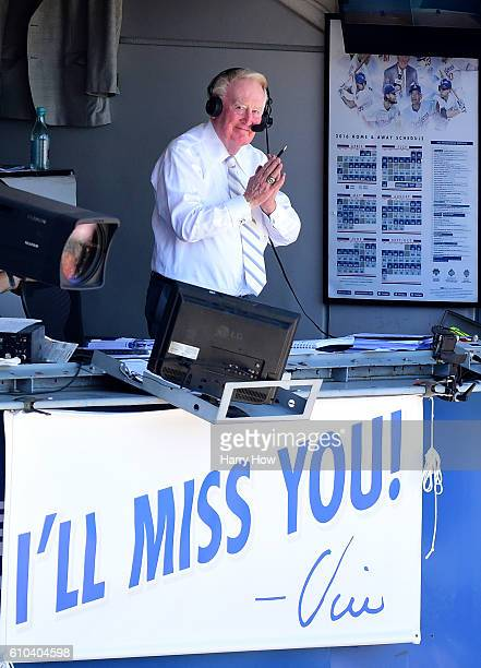 Los Angeles Dodgers announcer Vin Scully motions to the crowd before his final home game after 67 years at the post before the game against the...
