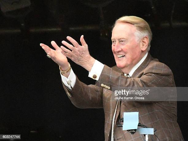 Los Angeles Dodgers broadcaster Vin Scully acknowledges the crowd before the game against the Arizona Diamondbacks at Dodger Stadium on September 6...