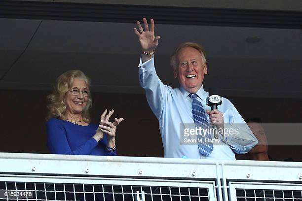 Los Angeles Dodgers broadcaster Vin Scully waves to the crowd alongside his wife Sandra Hunt before the Dodgers take on the Chicago Cubs in game five...