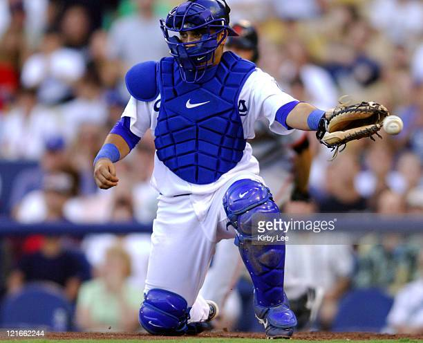 Los Angeles Dodgers catcher Dioner Navarro misplays a throw to home plate in the fifth inning that allowed Ray Durham of the San Francisco Giants to...