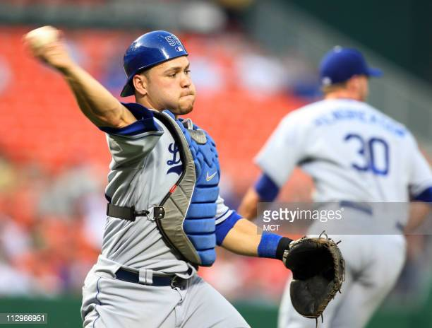 Los Angeles' Dodgers' catcher Russell Martin throws out the Washington Nationals' Micah Bowie on a sacrifice bunt in the fourth inning of their game...