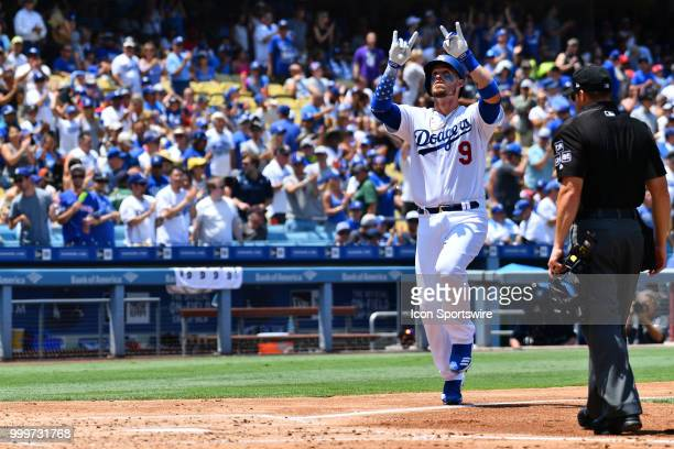 Los Angeles Dodgers catcher Yasmani Grandal celebrates a home run during a MLB game between the Los Angeles Angels of Anaheim and the Los Angeles...