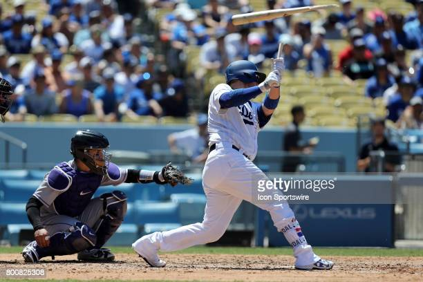 Los Angeles Dodgers catcher Yasmani Grandal shatters his bat during the game against the Colorado Rockies on June 25 at Dodger Stadium in Los Angeles...