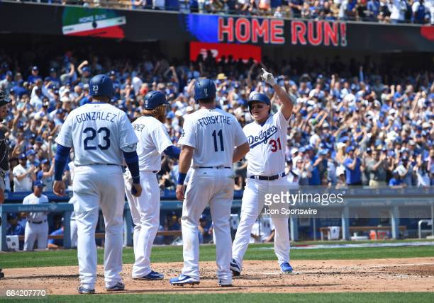 Los Angeles Dodgers Center field Joc Pederson celebrates after hitting a grand slam in the bottom of the third inning during an MLB opening day game...