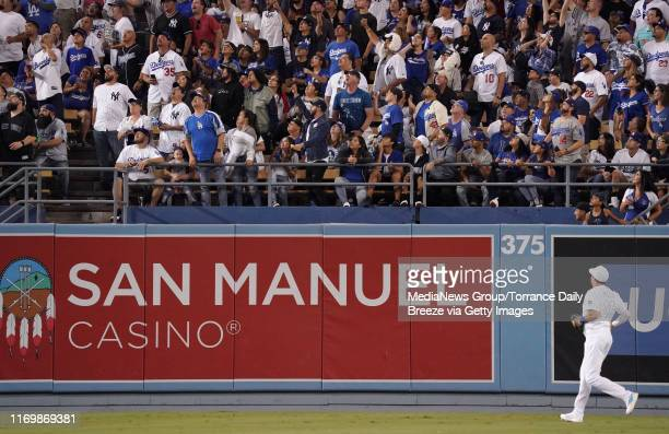 Los Angeles Dodgers center fielder A.J. Pollock watches a solo home run hit by New York Yankees catcher Gary Sanchez go over the fence at Dodger...