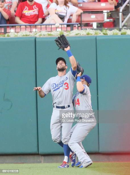 Los Angeles Dodgers center fielder Chris Taylor left collides with right fielder Kike Hernandez as he catches a fly ball bythe St Louis Cardinals'...