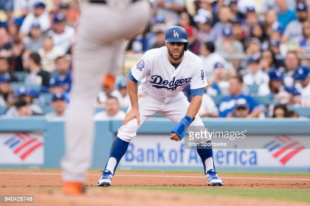 Los Angeles Dodgers center fielder Chris Taylor watches San Francisco Giants relief pitcher Derek Holland as he pitches in the first inning during...