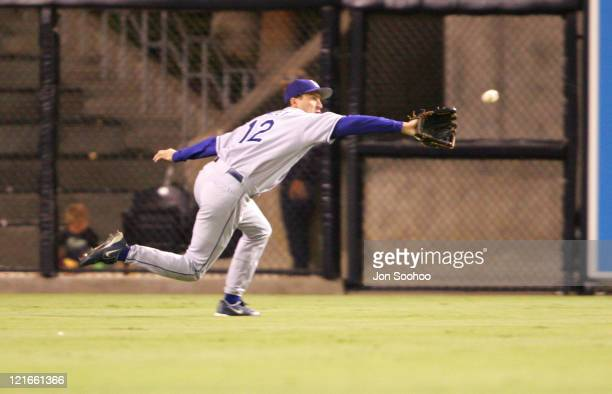 Los Angeles Dodgers center fielder Steve Finley makes play on San Diego Padres Mark Loretta Tuesday September 21 2004 at Petco Field in San Diego...
