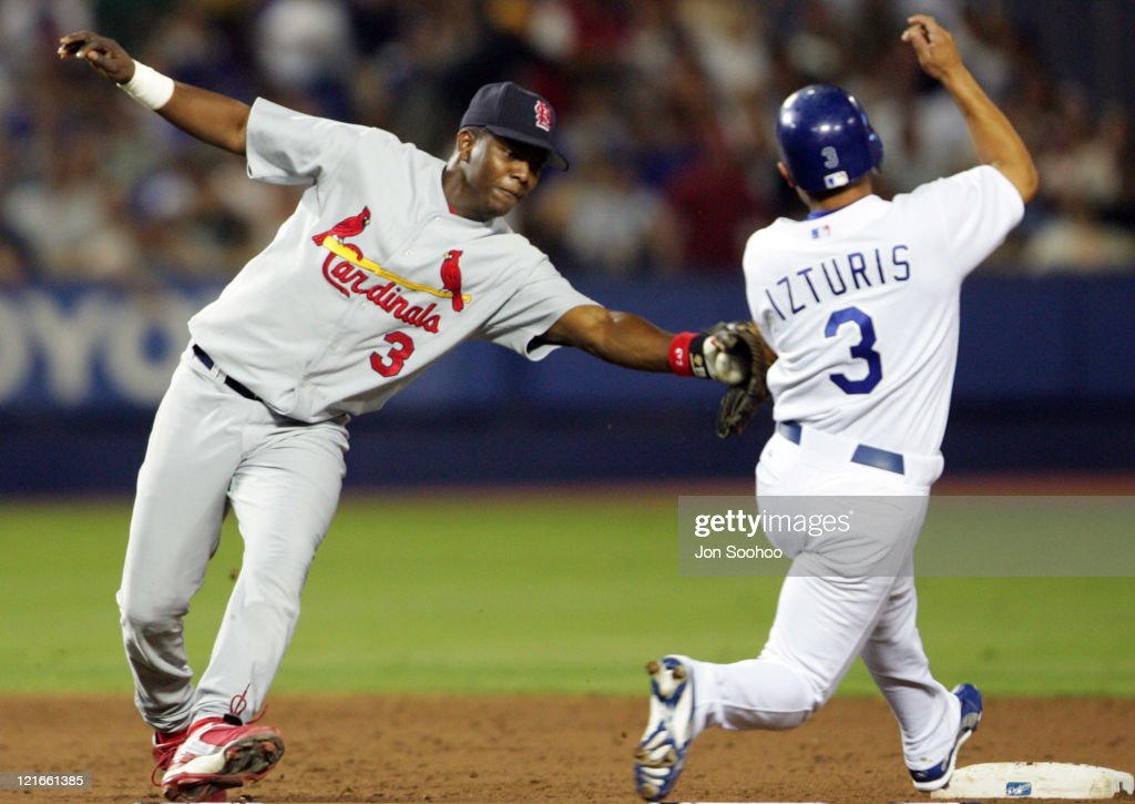 Los Angeles Dodgers Cesar Izturis, steals second base in the third inning as St. Louis Cardinals Edgar Renteria fails to make the tag Friday, September 10, 2004. The Dodgers beat the Cardinals, 7-6.