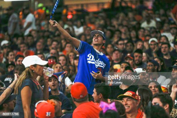 Los Angeles Dodgers fan cheers amongst the Astros fans during the Houston Astros World Series watch party at Minute Maid Park on October 31 2017 in...
