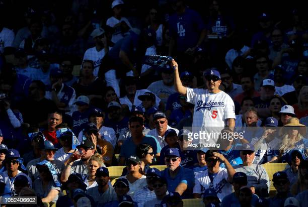 Los Angeles Dodgers fan cheers during the sixth inning of Game 5 of the NLCS against the Milwaukee Brewers at Dodger Stadium on Wednesday October 17...