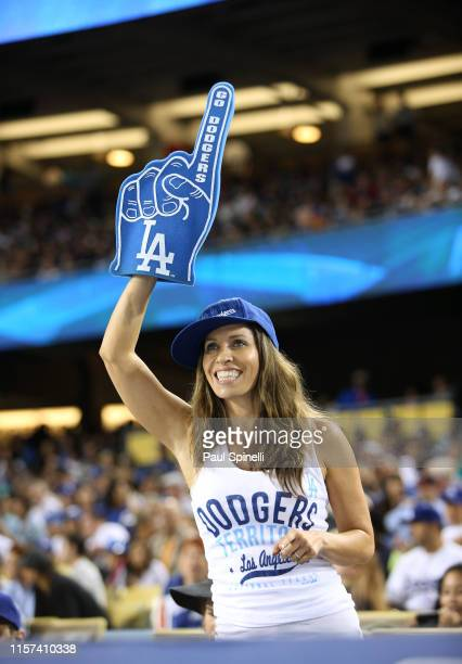Los Angeles Dodgers fan holds up a foam finger as she cheers during the game against the New York Mets at Dodger Stadium on Friday August 22 2014 in...