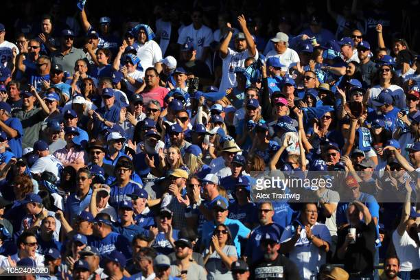 Los Angeles Dodgers fans cheer during the fifth inning of Game 5 of the NLCS against the Milwaukee Brewers at Dodger Stadium on Wednesday October 17...