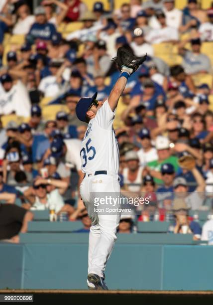 Los Angeles Dodgers first baseman Cody Bellinger gets under a fly ball during a MLB game between the Los Angeles Angels of Anaheim and the Los...