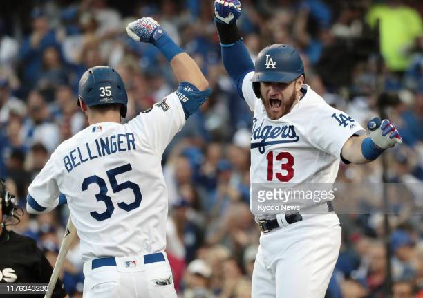 Los Angeles Dodgers first baseman Max Muncy celebrates with teammate Cody Bellinger after hitting a home run against the Washington Nationals in the...