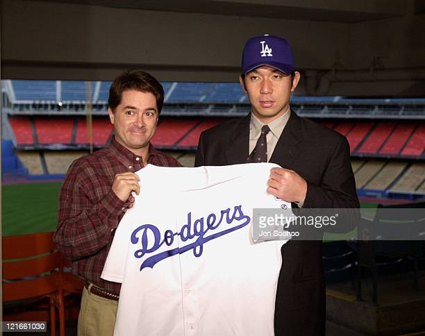 Los Angeles Dodgers General Manager Dan Evans with newest acquisition Hideo Nomo during press conference at Dodger Stadium. Nomo signed a 2 - year...