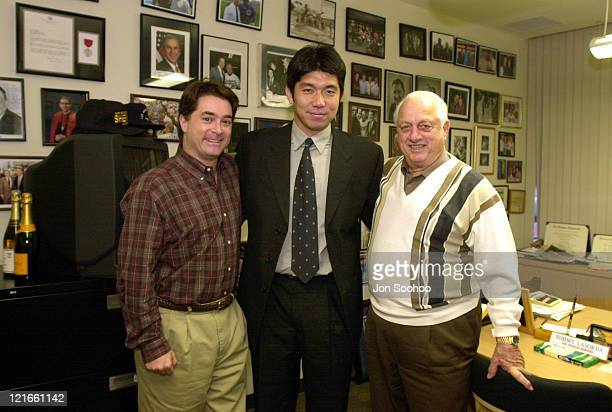 Los Angeles Dodgers General Manager Dan Evans with newest acquisition Hideo Nomo and Dodgers Tom Lasorda prior to press conference at Dodger Stadium....