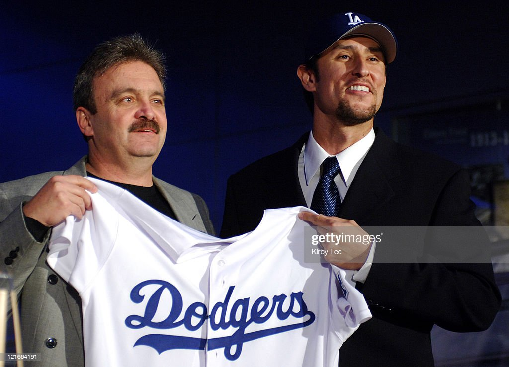 Los Angeles Dodgers general manager Ned Colletti (left) and Nomar Garciaparra pose at press conference to announce signing of Garciaparra to a one-year contract at Dodger Stadium in Los Angeles, Calif. on Monday, December 19, 2005.