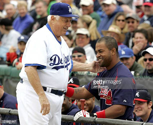 Los Angeles Dodgers Hall of Fame Manager Tommy Lasorda visits with former Dodger and current Braves Raul Mondesi pregame at Dodgertown in Vero...