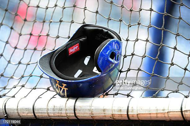 Los Angeles Dodgers helmet rests on the batting cage before the game against the Atlanta Braves at Turner Field on May 17 2013 in Atlanta Georgia