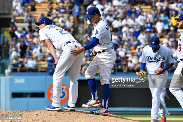 Los Angeles Dodgers infielder Enrique Hernandez give Los Angeles Dodgers pitcher Walker Buehler as he is pulled from the game during the National...