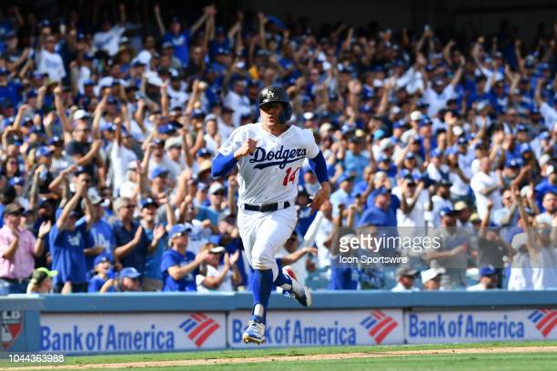 Los Angeles Dodgers infielder Enrique Hernandez heads toward home during the National League West division tiebreaker game between the Colorado...