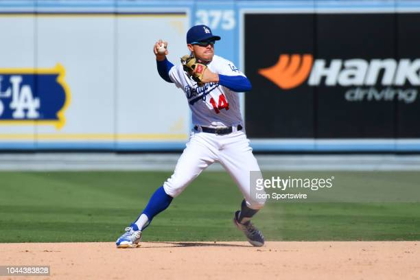 Los Angeles Dodgers infielder Enrique Hernandez makes a tough play during the National League West division tiebreaker game between the Colorado...