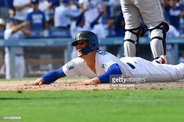 Los Angeles Dodgers infielder Enrique Hernandez slides safely into home during the National League West division tiebreaker game between the Colorado...