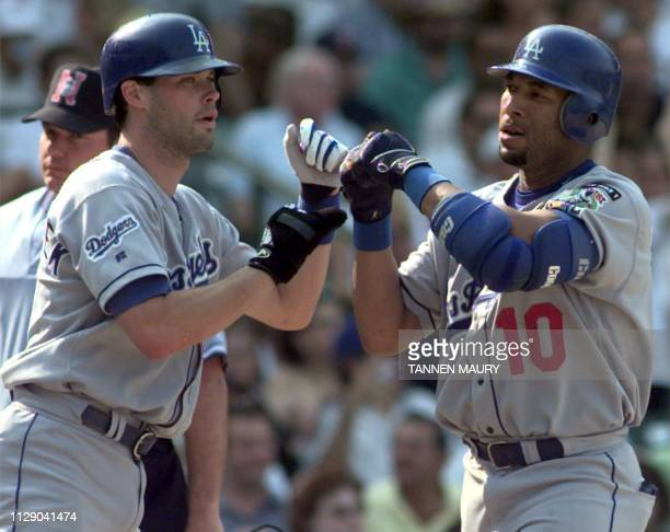 Los Angeles Dodgers infielder Mark Grudzielanek congratulates outfielder Gary Sheffield after Sheffield hit a home run in the top of the fifth inning...