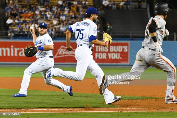Los Angeles Dodgers infielder Max Muncy makes an error as San Francisco Giants outfielder Steven Duggar reaches base in the ninth inning during a MLB...