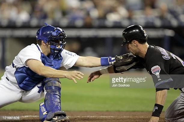 Los Angeles Dodgers Jason Phillips tags out Arizona Diamondbacks Luis Gonzalez on the arm Monday, April 25, 2005 at Dodger Stadium in Los...