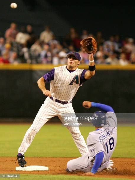 Los Angeles Dodgers Jose Hernandez slides in safely under Arizona Diamondbacks shortstop Alex Cintron in the 3rd inning Tuesday August 31 2004 at...