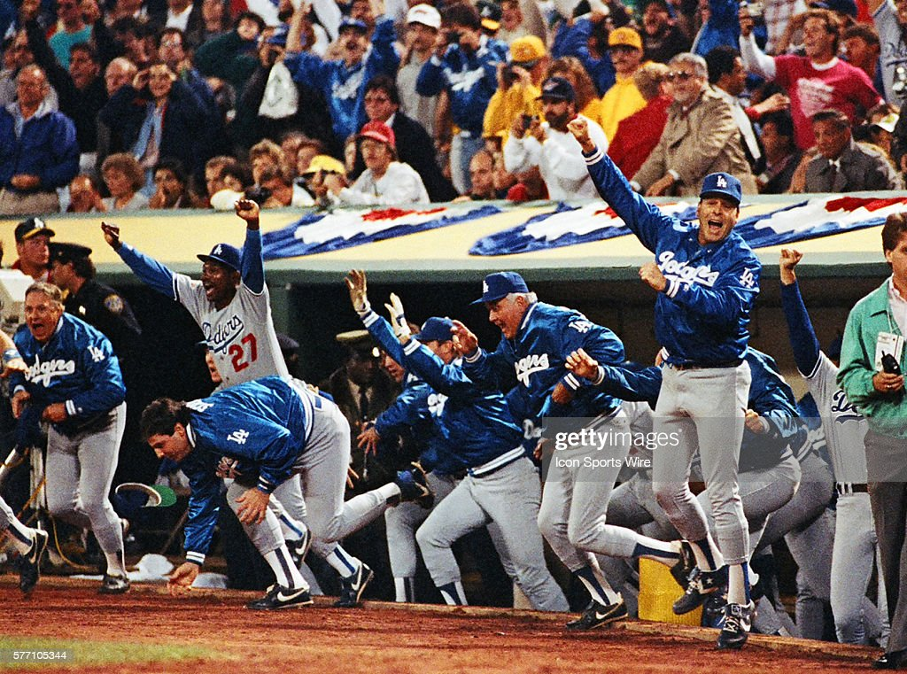 Los Angeles Dodgers leap out of their dugout beating the Oakland As in game 5 of the 1988 World Series in Oakland, California.