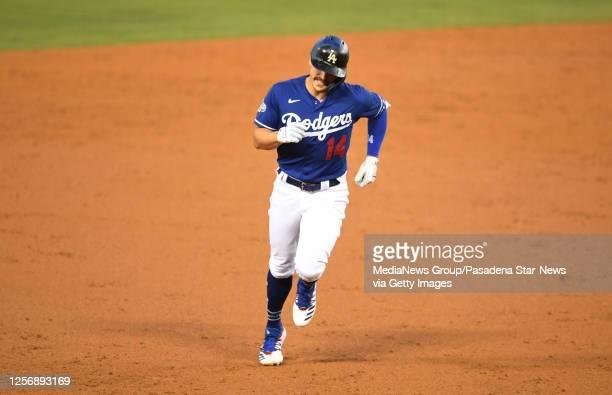 Los Angeles Dodgers left fielder Enrique Hernandez rounds second base after hitting a solo homer run off Los Angeles Dodgers starting pitcher Clayton...