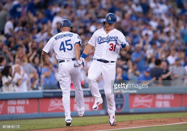 Los Angeles Dodgers left fielder Joc Pederson celebrates with Los Angeles Dodgers third base coach Chris Woodward after hitting aa homer in the...