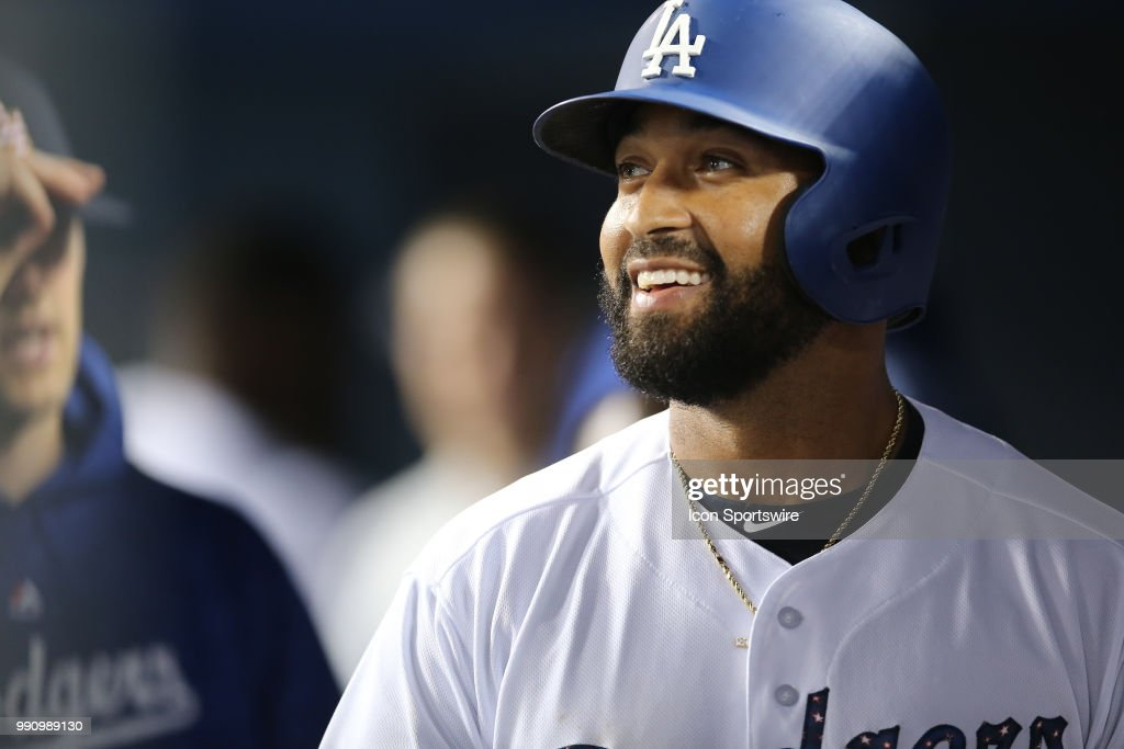 Los Angeles Dodgers left fielder Matt Kemp (27) smiles in the dugout after watching the replay of his three run homer in the game between the Pittsburg Pirates and the Los Angeles Dodgers, Dodger Stadium, Los Angeles, CA.
