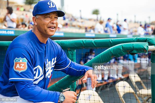 Los Angeles Dodgers manager Dave Roberts looks on during a spring training game against the Chicago White Sox at Camelback Ranch on March 3 2016 in...