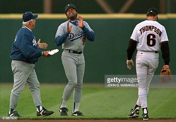 Los Angeles Dodgers manager Tommy Lasorda tries to calm Dodgers first base coach Reggie Smith after he was ejected from the game by second base...