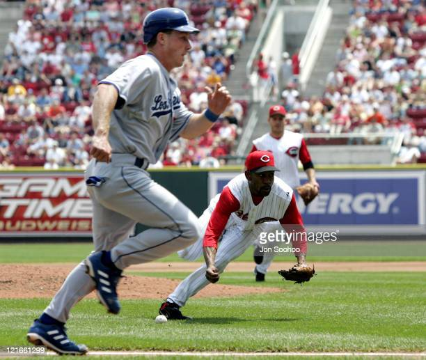 Los Angeles Dodgers Mike Edwards scores as Cincinnati Reds pitcher Ramon Ortiz mishandles suicide squeeze in the fourth inning Saturday May 7 2005 at...