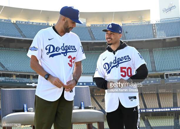 Los Angeles Dodgers Mookie Betts and David Price adjust their jerseys as they are introduced at a press conference at Dodger Stadium on February 12...