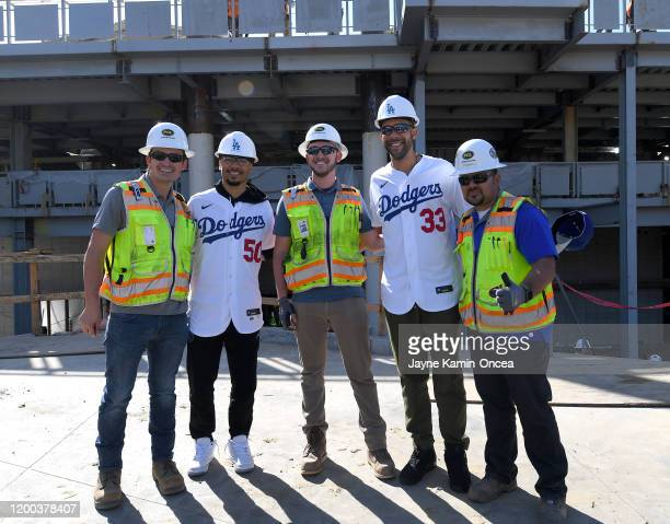 Los Angeles Dodgers Mookie Betts and David Price pose with construction workers as they take a tour of the new outfield pavillion construction after...