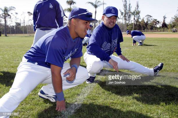 Los Angeles Dodgers' Norihiro Nakamura of Japan stretches with teammate Cesar Izturis during workout at Dodgertown in Vero Beach Florida on Wednesday...