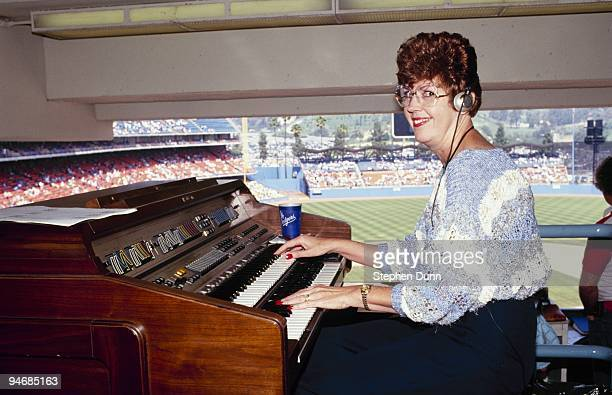 Los Angeles Dodgers organist Nancy Bea Heffley plays during the game against the San Diego Padres at Dodger Stadium on April 12 1991 in Los Angeles...