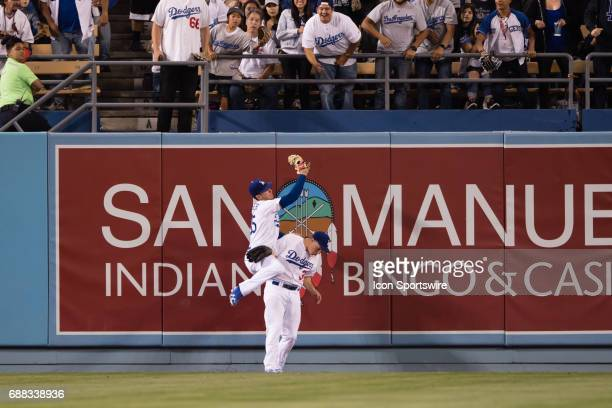 Los Angeles Dodgers Outfield Cody Bellinger and Los Angeles Dodgers Center field Joc Pederson collide as they both go for a deep hit fly ball during...